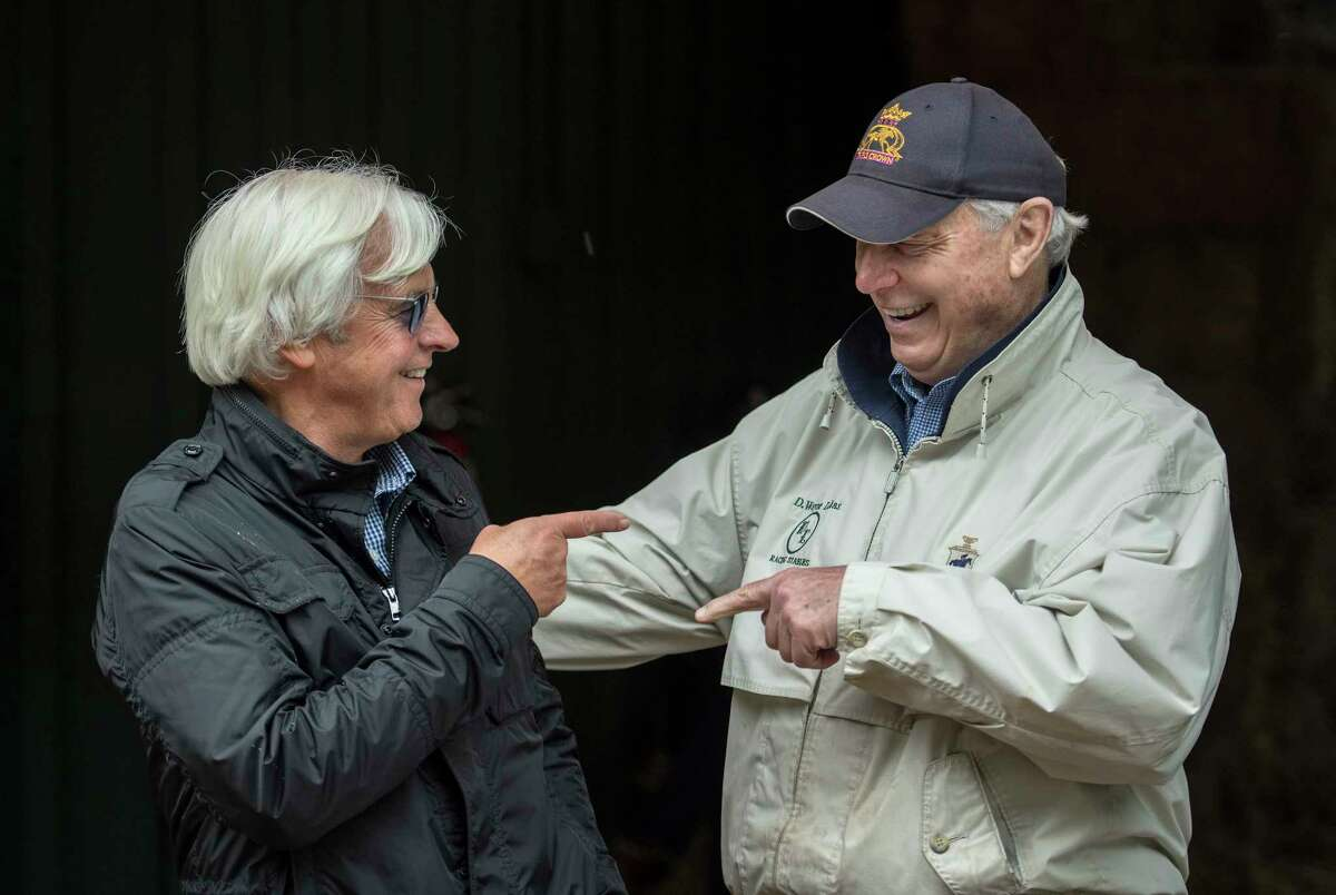Justify's trainer Bob Baffert enjoys a funny moment with Bravazo and Sporting Chance's trainer D. Wayne Lukas at the Pimlico Race Course on Preakness Day Friday May 18, 2018 in Baltimore, MD. (Skip Dickstein/Times Union)