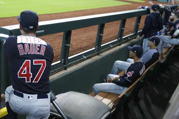 """Cleveland Indians pitcher Trevor Bauer (47)  in the dugout with a scotch taped """" Tyler"""" over his name during the first inning of an MLB baseball game at Minute Maid Park, Friday, May 18, 2018, in Houston. Bauer got into a Twitter argument with the Astros a few weeks ago and Alex Bregman called him Tyler. ( Karen Warren  / Houston Chronicle )"""