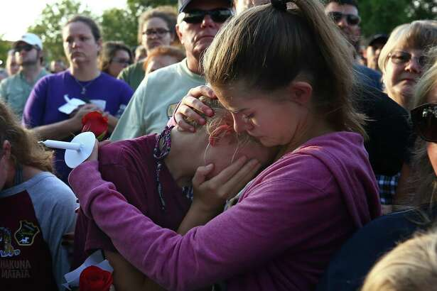 Abigail Adams, right, comforts her friend Hannah Hershey, 13, during a vigil for the victims of the Santa Fe High School mass shooting Friday, May 18, 2018, in Santa Fe, Texas. Hershey said she knew one of the 10 people who were killed at the high school earlier that day.