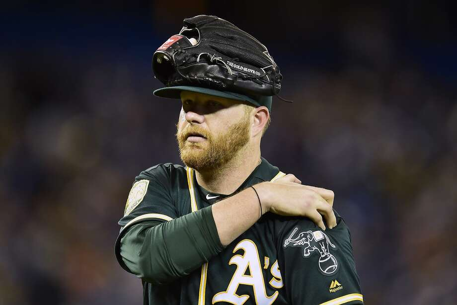 Oakland Athletics starting pitcher Brett Anderson leaves a baseball game while holding his shoulder in the second inning against the Toronto Blue Jays in Toronto on Friday, May 18, 2018. (Frank Gunn/The Canadian Press via AP) Photo: Frank Gunn / Associated Press