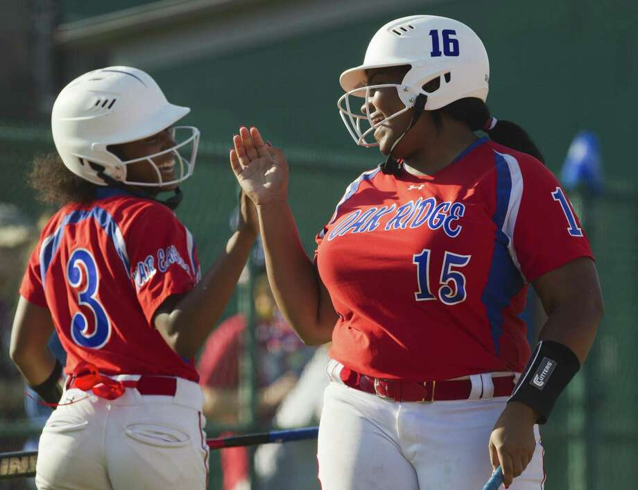 Oak Ridge's Taylor Brandon, right, shares a laugh with Rhian Journey after Journey scored on an error in the first inning of Game 2 during a Region II-6A semifinal series at Montgomery High School, Friday, May 18, 2018, in Montgomery. Photo: Jason Fochtman, Staff Photographer / Houston Chronicle / © 2018 Houston Chronicle