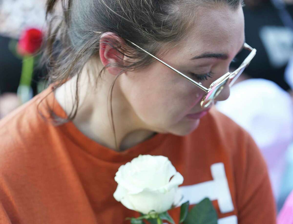 A tear rolls down a girl's face during a candlelight vigil for victims and survivors of the Santa Fe High School shooting at Texas First Bank on Friday, May 18, 2018, in Santa Fe. Hundreds participated and Gov. Greg Abbott and U.S. Sen. Ted Cruz also spoke at the vigil.