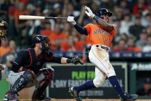 Houston Astros Tony Kemp (18) hits his ground rule double during the seventh inning of an MLB baseball game at Minute Maid Park, Friday, May 18, 2018, in Houston.