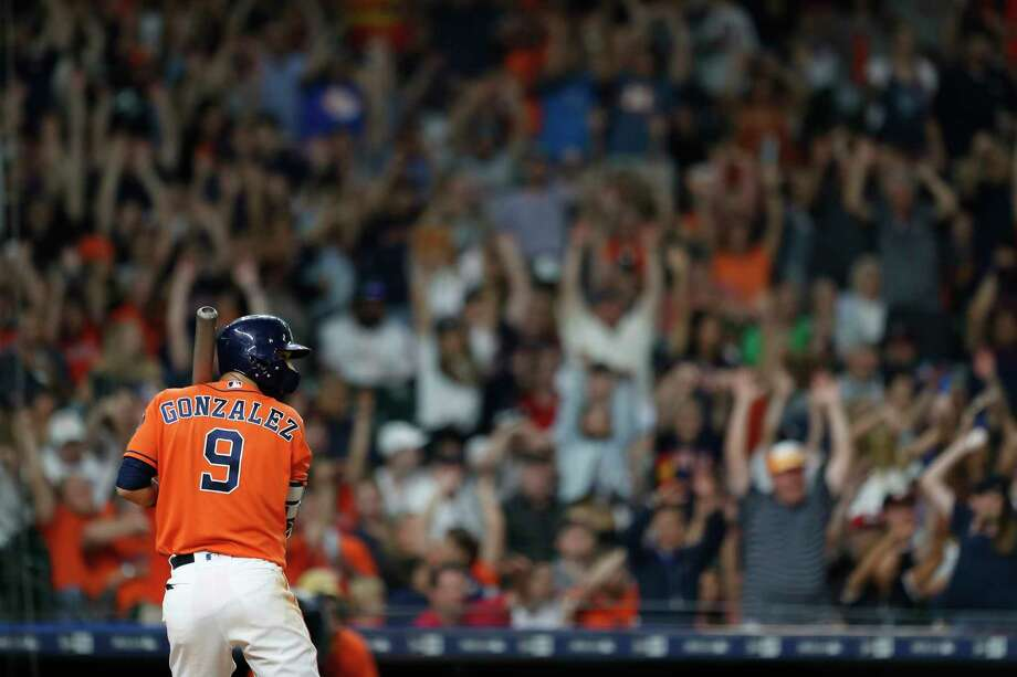 Houston Astros left fielder Marwin Gonzalez (9) bats with fans doing the wave during the seventh inning of an MLB baseball game at Minute Maid Park, Friday, May 18, 2018, in Houston. Photo: Karen Warren, Houston Chronicle / © 2018 Houston Chronicle