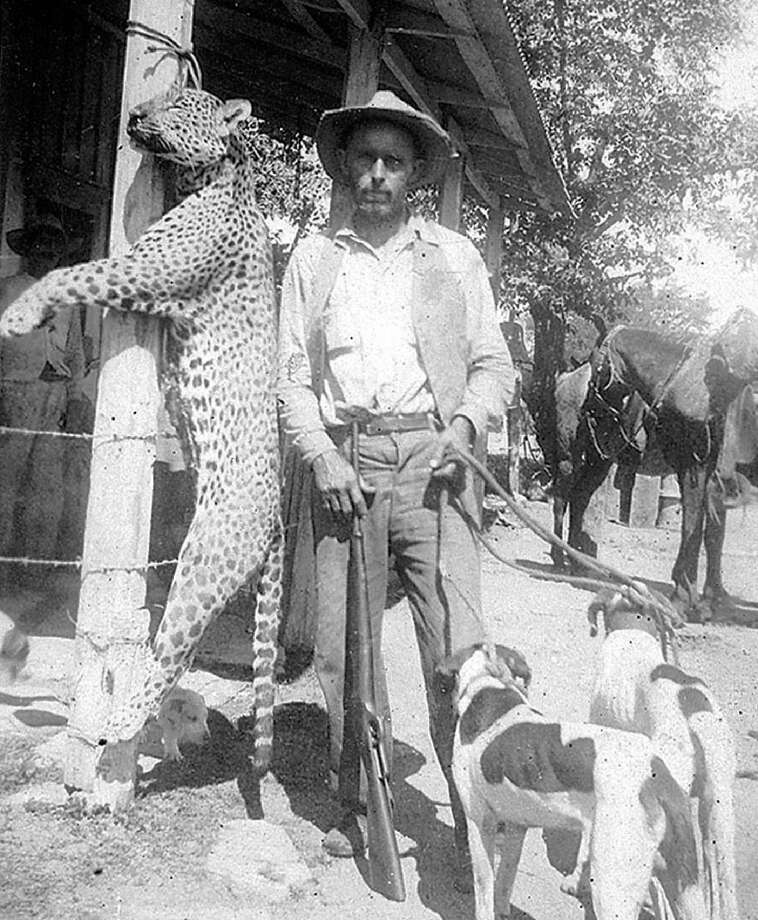 Cecil Thompson and his hunting dogs show off a jaguar they killed in the nearby mountains early in the 20th century. Jaguars and mountain lions preyed on calves and other animals, belonging to the early American colonists in Mexico. Photo Courtesy of Blalock Mexico Colony Project Photo: Blalock Mexico Colony Project