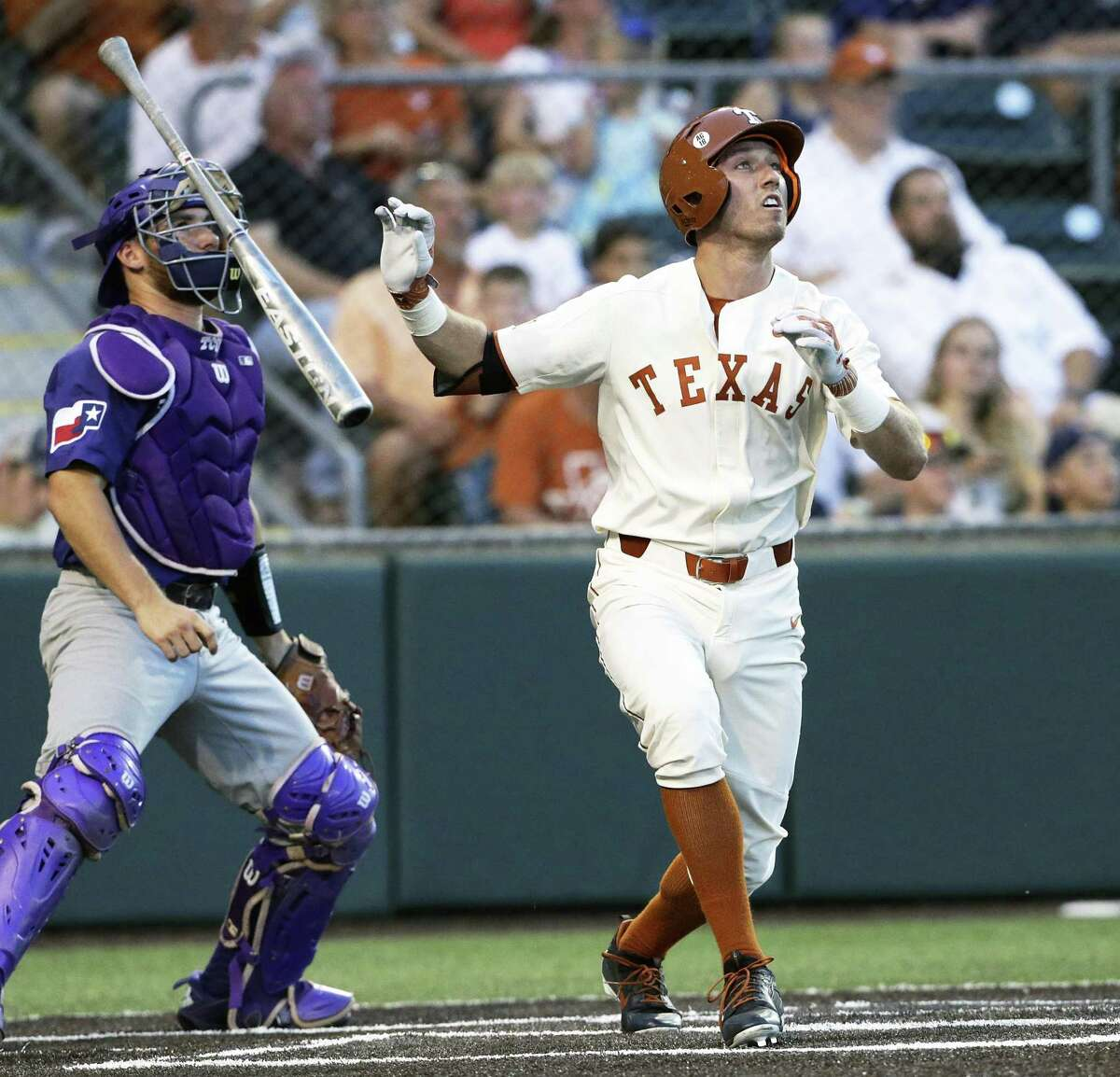 Kody Clemens watches his shot to right field clear the fence for a 2 run homer to tie the game 3-3 in the fifth inning as UT hosts TCU in men's baseball at Disch-Falk Field on May 18, 2018.