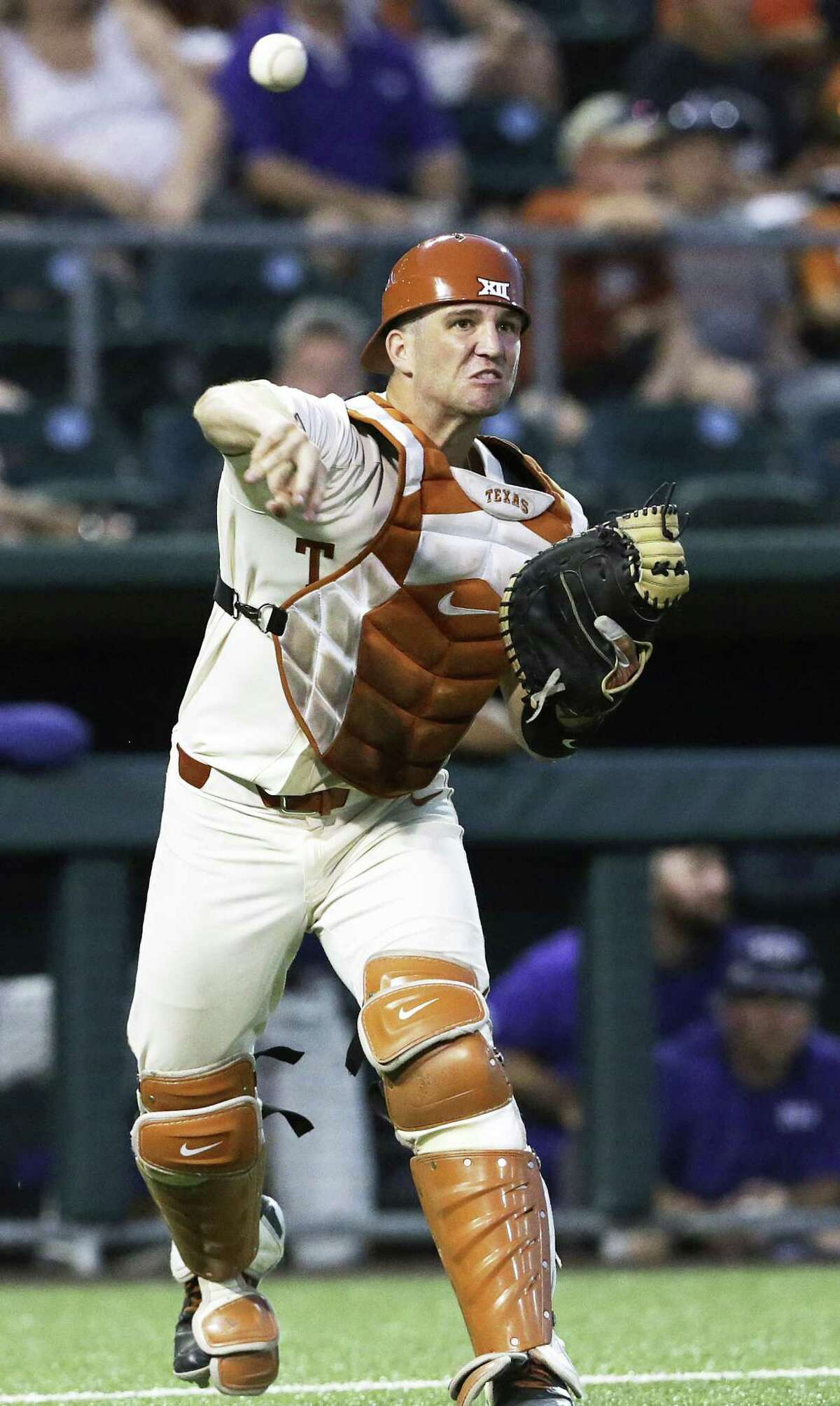 Longhorn catcher DJ Petrinsky throws out a runner at first on a bunt try as UT hosts TCU in men's baseball at Disch-Falk Field on May 18, 2018.