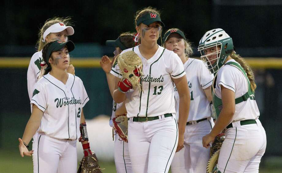 The Woodlands shortstop Abby Jones (2) reacts beside starting pitcher Emiley Kennedy (13) after Paige Harris #21 of Rockwall is called safe at first during the fourth inning of Game 1 in a Region II-6A quarterfinal series on Thursday, May 10, 2018, in The Woodlands. The Woodlands defeated Rockwall 2-1. Photo: Jason Fochtman, Staff Photographer / Houston Chronicle / © 2018 Houston Chronicle