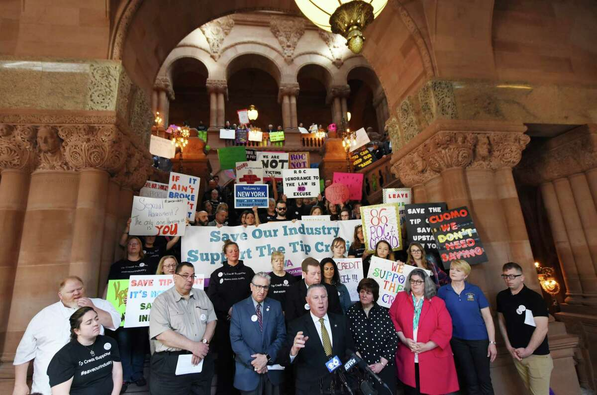 Assemblyman John T. McDonald III, center, speaks during a rally and press conference to demonstrate against a proposed plan to eliminate the stateOs tip credit on Friday, May 18, 2018, in Albany, N.Y. Tip credit is the amount between what a tipped employee makes and what the established minimum wage is. Gov. Andrew Cuomo directed the Commissioner of Labor to set up public hearings to look at the possibility of eliminating minimum wage tip credits across the state. (Will Waldron/Times Union)