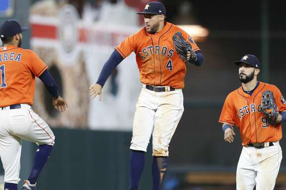 Houston Astros George Springer (4) celebrates with Carlos Correa after the Astros win over the Cleveland Indians after an MLB baseball game at Minute Maid Park, Friday, May 18, 2018, in Houston. ( Karen Warren  / Houston Chronicle )