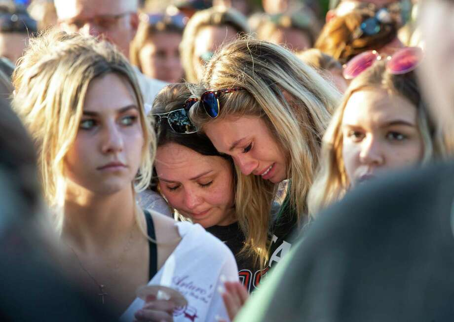 Women embrace during a prayer vigil following a shooting at Santa Fe High School in Santa Fe, Texas, on Friday, May 18, 2018. Seventeen-year-old Dimitrios Pagourtzis is charged with capital murder in the deadly shooting rampage. (Stuart Villanueva The Galveston County Daily News via AP) Photo: Stuart Villanueva / © 2018 Stuart Villanueva/The Galveston County Daily News