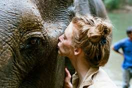 "Director Ashley Bell and friend in the documentary ""Love & Bananas: An Elephant Story."""