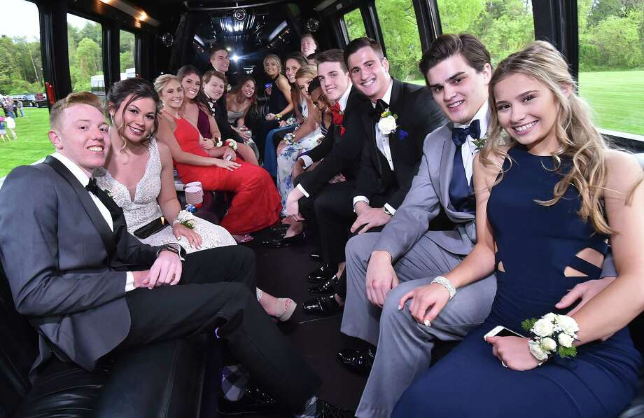 North Haven High School students gather at the pond at Quinnipiac University North Haven Campus for photos with their families and friends on prom night Friday, May 18, 2018. Photo: Catherine Avalone, Hearst Connecticut Media / New Haven Register