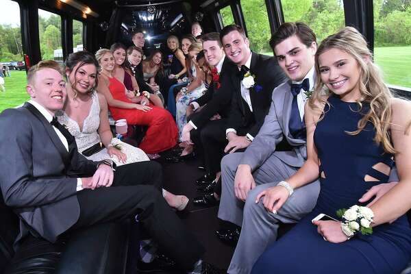 North Haven High School students gather at the pond at Quinnipiac University North Haven Campus for photos with their families and friends on prom night Friday, May 18, 2018.