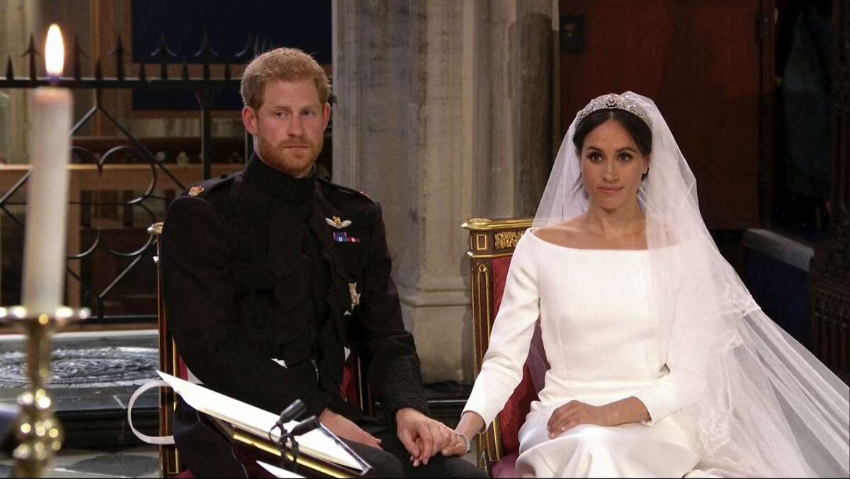 In this frame from video, Britain's Prince Harry and Meghan Markle listen at their wedding ceremony at St. George's Chapel in Windsor Castle in Windsor, near London, England, Saturday, May 19, 2018. (UK Pool/Sky News via AP)