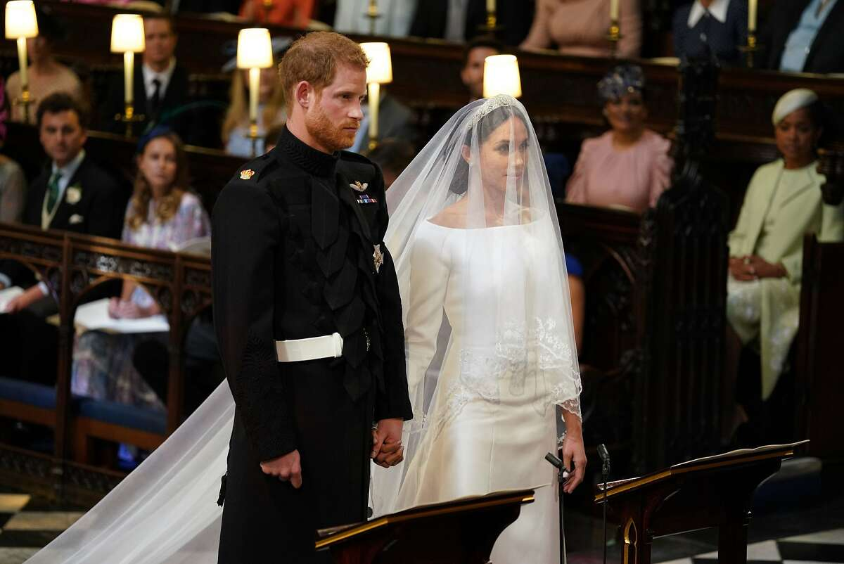 WINDSOR, UNITED KINGDOM - MAY 19: Prince Harry and Meghan Markle stand together in St George's Chapel at Windsor Castle for their wedding on May 19, 2018 in Windsor, England. (Photo by Dominic Lipinski - WPA Pool/Getty Images)
