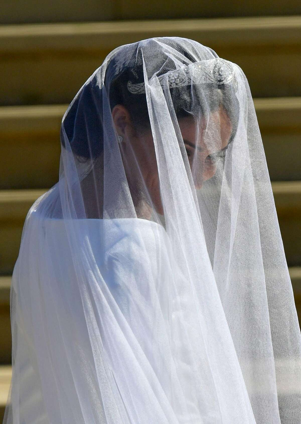 WINDSOR, UNITED KINGDOM - MAY 19: Meghan Markle arrives at St George's Chapel at Windsor Castle for her wedding to Prince Harry on May 19, 2018 in Windsor, England. (Photo by Ben Birchall - WPA Pool/Getty Images)