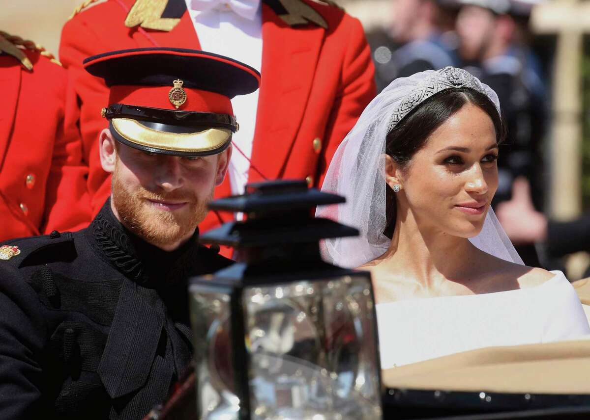 Britain's Prince Harry and his wife Meghan Markle leave after their wedding ceremony at St. George's Chapel in Windsor Castle in Windsor, near London, England, Saturday, May 19, 2018.