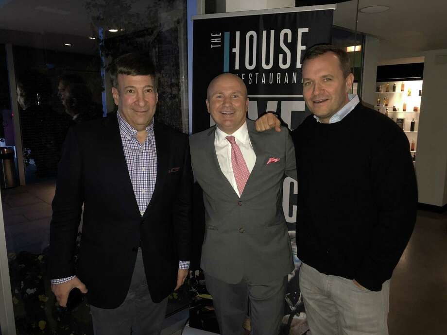 "Tony Capasso, center, new food and beverage manager at J House Greenwich, welcomes Greenwich resident and radio/TV personality Mark Simone, left, and former ""Good Day New York"" co-host Greg Kelly, right. Photo: Contributed /"