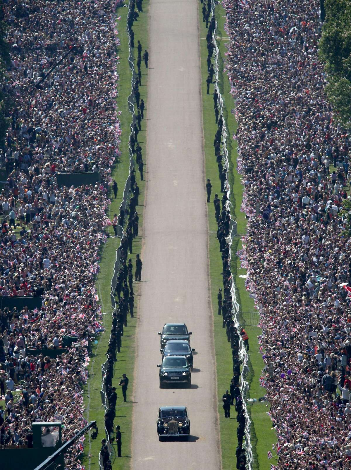 Meghan Markle and her mother, Doria Ragland, are driven along the Long Walk as they arrive for her wedding ceremony to marry Britain's Prince Harry, Duke of Sussex, at St George's Chapel, Windsor Castle, in Windsor, on May 19, 2018.