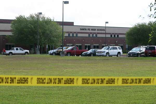 Crime scene tapes remain on the parameter of Santa Fe High School on Saturday, May 19, 2018, in Santa Fe. The shooting on Friday killed 10 people and injured another 10. Students could pick up their vehicles and personal items begin at noon on Saturday.