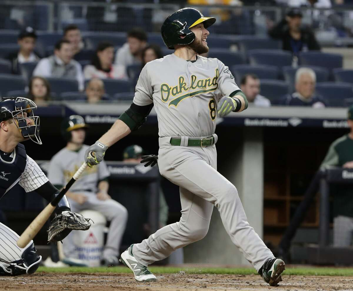 Oakland Athletics' Jed Lowrie watches his RBI single during the third inning of a baseball game against the New York Yankees on Friday, May 11, 2018, in New York. (AP Photo/Frank Franklin II)