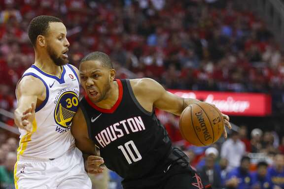 Houston Rockets guard Eric Gordon (10) drives around Golden State Warriors guard Stephen Curry (30) during the first half in Game 1 of the NBA Western Conference Finals at Toyota Center on Monday, May 14, 2018, in Houston. ( Brett Coomer / Houston Chronicle )