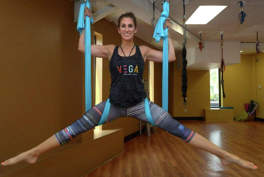 Lo Vega, an ariel fitness specialist, teaches Bungee Fusion Fitness at Anytime Fitness Tuesday, May 15, 2018, in Norwalk, Conn. Photo: Erik Trautmann / Hearst Connecticut Media / Norwalk Hour