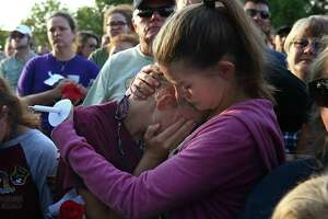 Abigail Adams, right, comforts her friend Hannah Hershey, 13, during a vigil for the victims of the Santa Fe High School mass shooting Friday, May 18, 2018, in Santa Fe, Texas. Hershey said she knew one of the 10 people who were killed at the high school earlier that day. ( Godofredo A. Vasquez / Houston Chronicle )