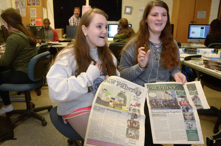 Norwalk High School journalism students and Co-Editors-In-Chief, Elise Sullivan and Hannah Keyes work on the school newspaper, the Paw Print, in Robert Karl's Jounalism class Wednesday, May 16, 2018, at the school in Norwalk, Conn. The Paw Print recently won second place for overall best paper in the 2017-18 American Scholastic Press Association contest. Photo: Erik Trautmann / Hearst Connecticut Media / Norwalk Hour