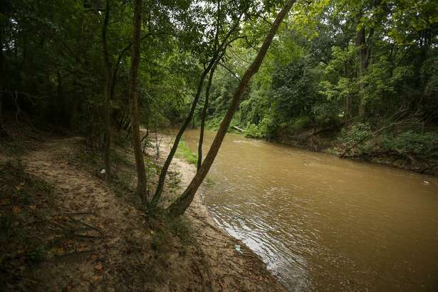The West Fork San Jacinto River flows by McDade Park on Friday, Aug. 25, 2017, in Conroe.