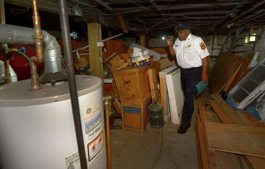 Norwalk Fire Department Fire Marshal Broderick Sawyer inspects the basement of a multi-family property Wednesday, May 16, 2018, at 4-½ Laura St. in South Norwalk, Conn. Norwalk Fire Department Fire Marshal's office is putting a dent in its lengthy backlog of inspections after having its staffing boosted. Photo: Erik Trautmann / Hearst Connecticut Media / Norwalk Hour