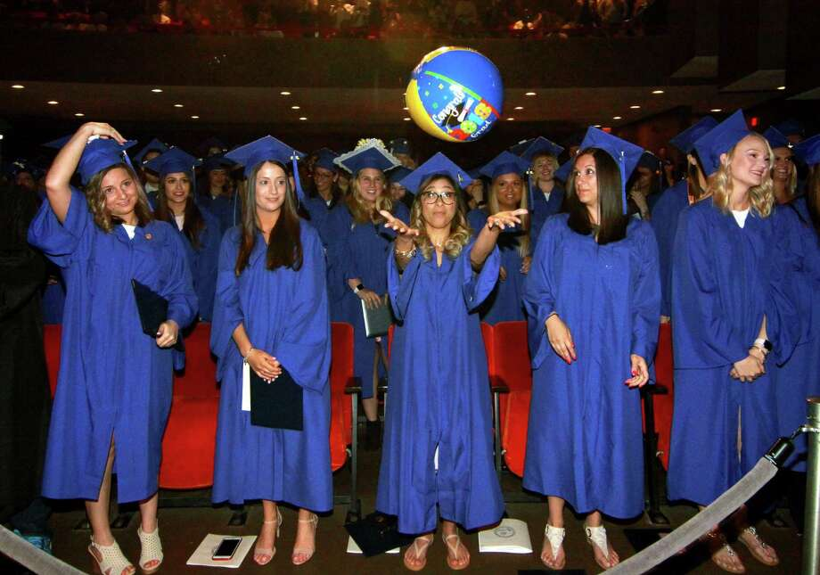 Elizabeth Walker, of Stratford, sends a beach ball back into the crowd during St. Vincent's College's 26th Annual Commencement Ceremony at Arnold Bernhard Arts & Humanities Center at the University of Bridgeport in Bridgeport, Conn., on Saturday, May 19, 2018. This class marks the last graduating class of nurses from St. Vincent's since a merger with Sacred Heart University. Photo: Christian Abraham / Hearst Connecticut Media / Connecticut Post