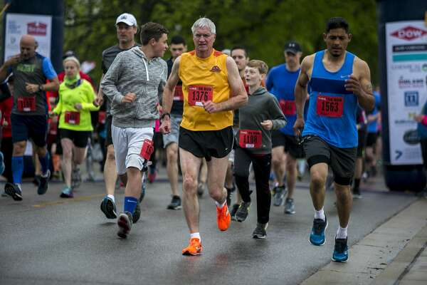 5K competitors take off from the starting line at the 33rd annual Greater Midland Dow RunWalk held in Midland on Saturday, May 19, 2018. (Josie Norris/for the Daily News)