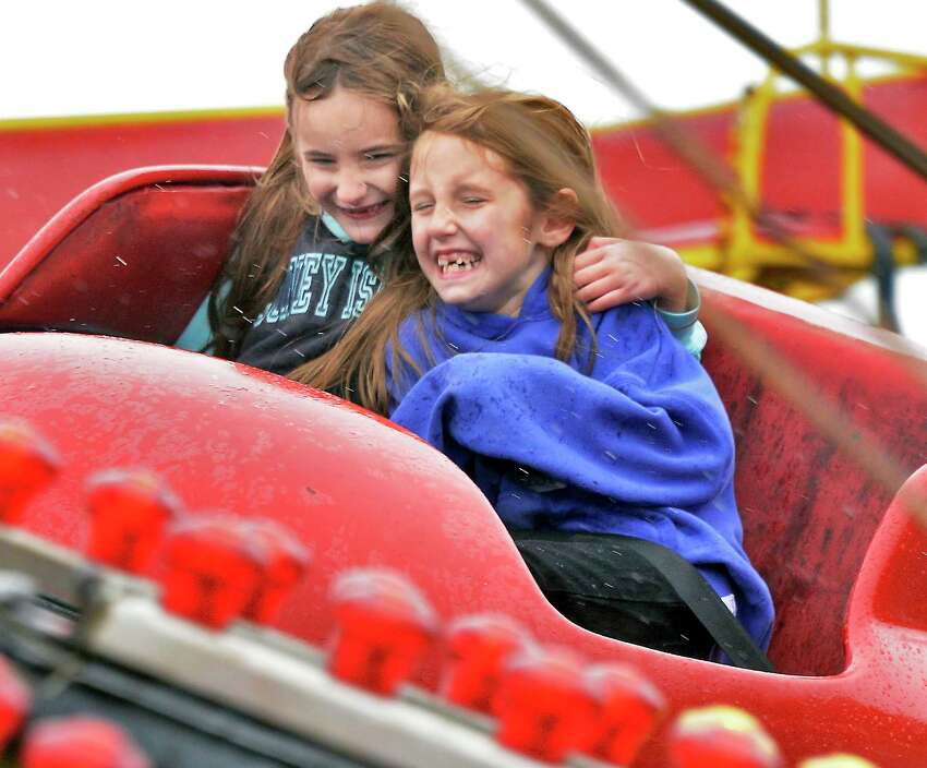 Seven-year-old twin sisters Chloe, left, and Abigail Paulus of Schenectady take a carnival ride at the 37th year Niska-Day Saturday May 19, 2018 in Niskayuna, NY. (John Carl D'Annibale/Times Union)