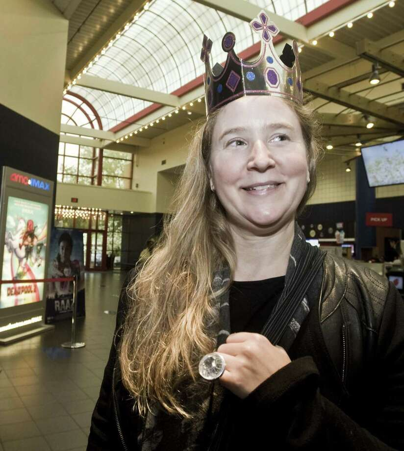 Alyssa Younger displays her ring and crown before entering a screening of the Royal Wedding at AMC Loews Theaters in Danbury. Saturday, May 19, 2018 Photo: Scott Mullin / For Hearst Connecticut Media / The News-Times Freelance