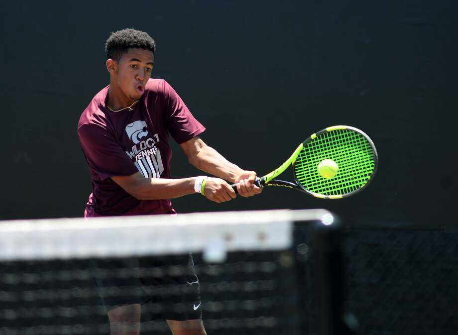 Clear Creek High School senior Michael Raji plays a backhand at the net during his Class 6A Boys Doubles Finals match with partner Carter Crookston, a sophomore, against the team from Austin Westlake at the 2017-2018 UIL State Tennis Championships at the George P. Mitchell Tennis Center on the campus of Texas A&M University in College Station on May 18, 2018. (Jerry Baker/For the Chronicle) Photo: Jerry Baker, Freelance / For The Chronicle / Freelance