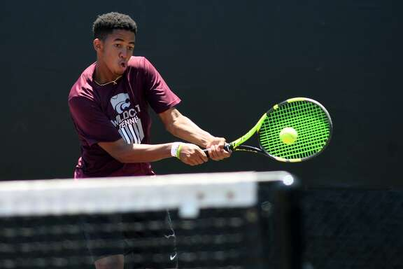 Clear Creek High School senior Michael Raji plays a backhand at the net during his Class 6A Boys Doubles Finals match with partner Carter Crookston, a sophomore, against the team from Austin Westlake at the 2017-2018 UIL State Tennis Championships at the George P. Mitchell Tennis Center on the campus of Texas A&M University in College Station on May 18, 2018. (Jerry Baker/For the Chronicle)