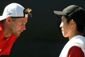 Pearland Dawson senior Kevin Zhu, right, gets a pep talk from his coach Ryan Walker during his Class 6A Boys Singles Finals match against Katy Tompkins High School senior Anish Sriniketh at the 2017-2018 UIL State Tennis Championships at the George P. Mitchell Tennis Center on the campus of Texas A&M University in College Station on May 18, 2018. (Jerry Baker/For the Chronicle)