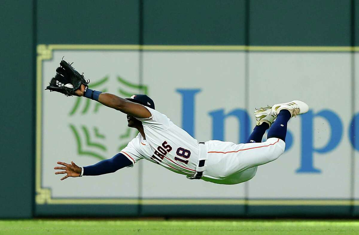 HOUSTON, TX - MAY 19: Tony Kemp #18 of the Houston Astros makes a diving catch on a line drive by Brandon Guyer #6 of the Cleveland Indians in the third inning at Minute Maid Park on May 19, 2018 in Houston, Texas.
