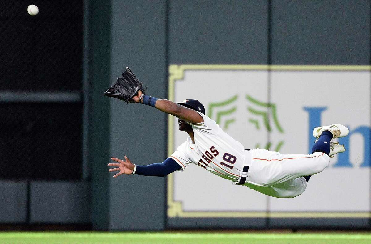 Houston Astros center fielder Tony Kemp catches a line drive by Cleveland Indians' Brandon Guyer during the third inning of a baseball game, Saturday, May 19, 2018, in Houston. (AP Photo/Eric Christian Smith)