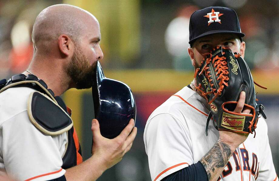 Houston Astros starting pitcher Dallas Keuchel, right, talks with catcher Brian McCann after Cleveland Indians' Edwin Encarnacion scored the third run of the first inning of a baseball game, Saturday, May 19, 2018, in Houston. (AP Photo/Eric Christian Smith) Photo: Eric Christian Smith, Associated Press / FR171023 AP
