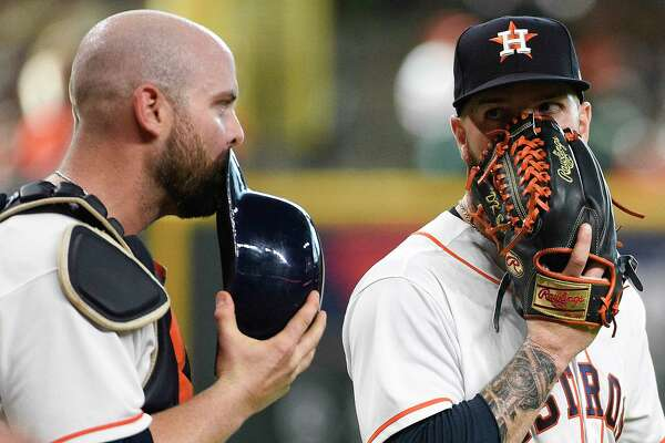 Houston Astros starting pitcher Dallas Keuchel, right, talks with catcher Brian McCann after Cleveland Indians' Edwin Encarnacion scored the third run of the first inning of a baseball game, Saturday, May 19, 2018, in Houston. (AP Photo/Eric Christian Smith)