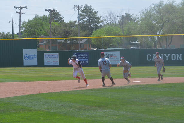 Gruver's Creed Spivey gets caught in a rundown with Abernathy shortstop Jake Ayers (middle) hot on his trail during the second game of the Class 2A, Region 1 quarterfinal series on Saturday in Canyon. Antelope teammates Bryson Daily (13) and Bradyn Daniel (right) back up the play.