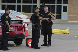 San Antonio Police investigate a scene where a female was allegedly ran over by a male suspect in his vehicle after an argument occurred between the two individuals along the 4500 block of Walzem Road on Saturday, May 19, 2018. Sgt. David Renn said two bystanders who happened to be concealed handgun owners that saw the woman getting ran over pulled over in their vehicle and opened fire on the male suspects vehicle. The suspect's vehicle had a blown out tire but still managed to flee the scene. Renn said the police are confident about apprehending the suspect and will likely face murder charges. (Kin Man Hui/San Antonio Express-News)