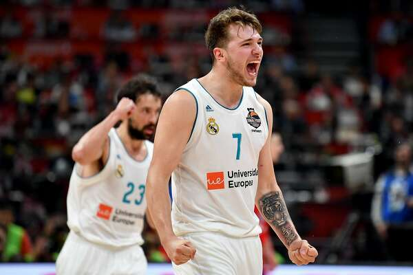 TOPSHOT - Real Madrid's Slovenian Luka Doncic (R) and Real Madrid's Spanish guard Sergio Llull react after scoring a point during the Euroleague Final Four second semi-final match between CSKA Moscow and Real Madrid at The Stark Arena in Belgrade on May 18, 2018. / AFP PHOTO / ANDREJ ISAKOVICANDREJ ISAKOVIC/AFP/Getty Images