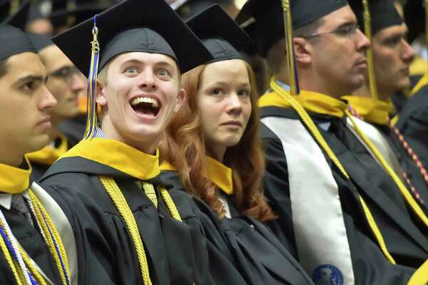Hamden, Connecticut - Saturday,  May 19, 2018: Jeremy Caulkins of Rochester, NY, looks at well-wishers in the stands during the 87th Quinnipiac University undergraduate commencement exercises for the School of Business Saturday afternoon at Quinnipiac's  TD Bank Sports Center in Hamden.