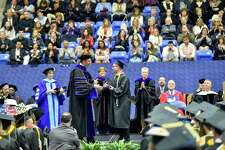 Hamden, Connecticut - Saturday,  May 19, 2018: The 87th Quinnipiac University undergraduate commencement exercises for the School of Business Saturday afternoon at Quinnipiac's  TD Bank Sports Center in Hamden.
