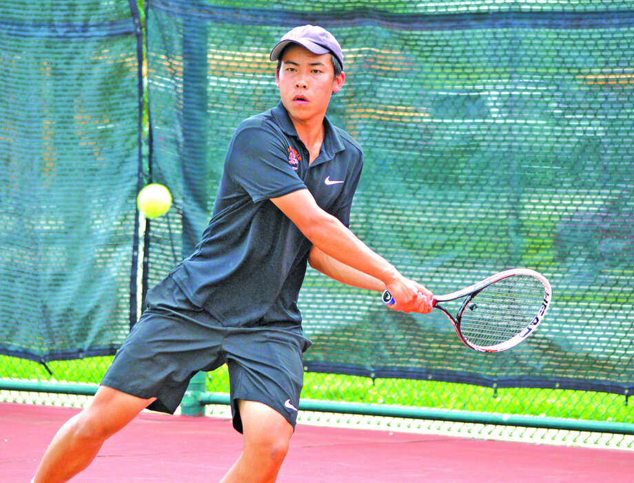 Edwardsville senior Jason Pan returns a shot during his doubles quarterfinal with partner Logan Pursell on Saturday during the Class 2A Belleville East Sectional.