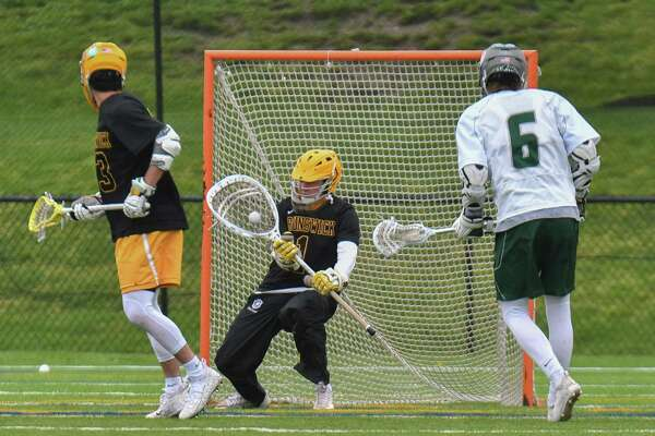 Goalie Patrick Burkinshaw (1) of the Brunswick Bruins makes a save during a game against the Berkshire Bears at the Brunswick School School on Saturday May 19, 2018, in Greenwich, Connecticut.